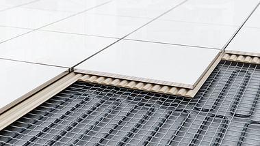 Eine unter Fliesen verlegte Fußbodenheizung.  - Foto: adventtr / iStock