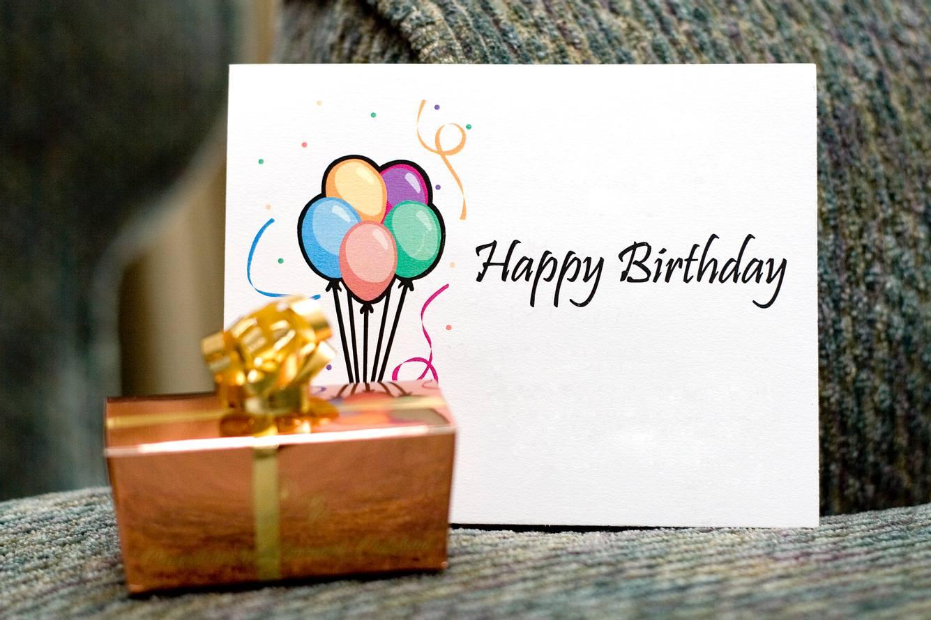 Geburtstagskarte mit Geschenk.